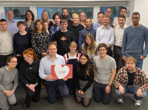 Some of the Mindful team with a #LoveOurColleges sign